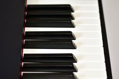 Keys of a digital piano, soft focusing, creative mood of a person improvisation and creativity. Midi piano keyboard for playing digital music and making royalty free stock photography