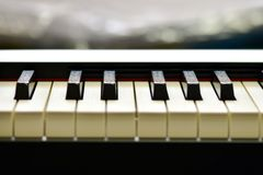 Keys of a digital piano, soft focusing, creative mood of a person improvisation and creativity. Midi piano keyboard for playing digital music and making stock images