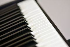 Keys of a digital piano, soft focusing, creative mood of a person improvisation and creativity. Midi piano keyboard for playing digital music and making royalty free stock photo