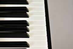 Keys of a digital piano, soft focusing, creative mood of a person improvisation and creativity. Midi piano keyboard for playing digital music and making royalty free stock image