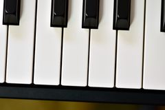 Keys of a digital piano, soft focusing, creative mood of a person improvisation and creativity. Midi piano keyboard for playing digital music and making stock photos