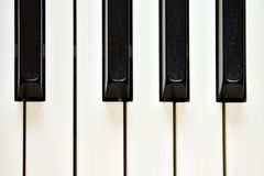 Keys of a digital piano, soft focusing, creative mood of a person improvisation and creativity. Midi piano keyboard for playing digital music and making stock photo