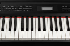 Keys of digital piano synthesizer Royalty Free Stock Image
