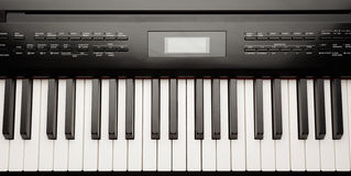Keys of digital piano synthesizer Royalty Free Stock Images