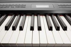 Keys of digital piano synthesizer. Closeup view Royalty Free Stock Photos