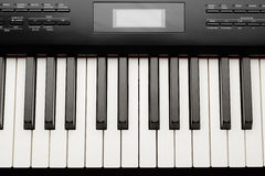 Keys of digital piano synthesizer Stock Images