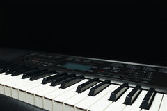 Keys of the digital synth on black background Stock Images