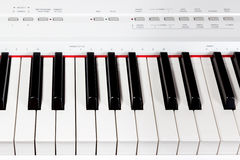 Keys of digital white piano synthesizer Royalty Free Stock Photography