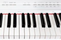 Keys of digital white piano synthesizer royalty free stock photography