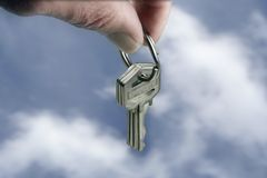 Keys dropped from the clouds. Keys royalty free stock image
