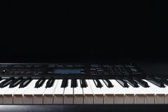 Keys of the electronic synth on black background Stock Image