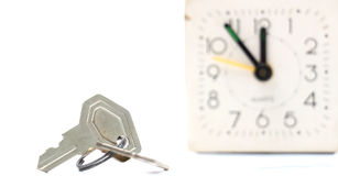 Keys in front of vintage alarm clock Royalty Free Stock Images