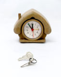 Keys in front of vintage house shape alarm clock Royalty Free Stock Images