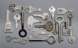 Keys on a Gray Background Royalty Free Stock Photography
