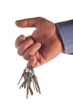 Keys are in a hand. The man's hand holds a charm with keys Stock Image