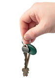 Keys in a hand. Isolated on white Royalty Free Stock Images