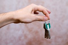 Keys in the hand stock photography