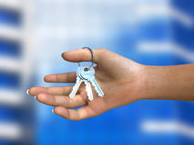 Keys in hand Stock Photos