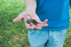 Keys in hand. Concept of buying house. Man holding keys from a new home Royalty Free Stock Image
