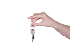 Keys in hand. Keys in a female hand on a white background Stock Image