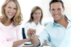 Keys in hands at the agency Royalty Free Stock Images