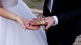 The keys in the hands of the bride and groom. Wedding tradition. stock video