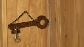 The keys hang on hooks on the wall stock video