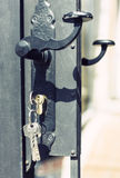 Keys hanging from door lock with door knob Stock Photography