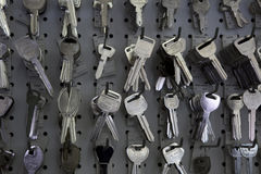 Keys hanging on hooks in store Stock Images