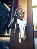Keys hanging in the keyhole of the gate. Bunch of keys in the keyhole of the gate Stock Photography