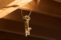Keys hanging from Rafters (Horizontal). A group of old keys handing from wooden rafters stock photography