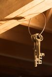 Keys hanging from Rafters (Vertical). A group of keys handing from wooden rafters royalty free stock images