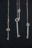 Keys hanging on strings Stock Photography