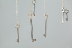 Keys hanging on strings Royalty Free Stock Photo