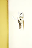 Keys Hanging on a White Metal Wall Hook Stock Image