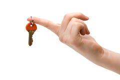 Keys hold on forefinger. Keys hold by female on forefinger royalty free stock image