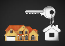 Keys and house. House keys with key chain on a black background Royalty Free Stock Images