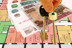 Keys from the house on the background of a credit card and money. Royalty Free Stock Photo