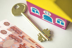 Keys from the house on the background of a credit card and money. Royalty Free Stock Photos