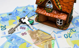 Keys and house on the background of the euro cash Stock Photo