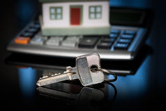Keys with house and calculator. Stock Photo