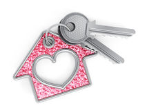 Keys and house pendant. With heart shape  on white background Royalty Free Stock Image