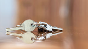 Keys. House keys resting on wooden table Stock Photo