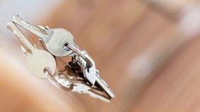 Keys. House keys resting on wooden table Stock Image