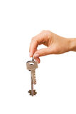 Keys from house in the women's hand. Isolated women's hand holding keys from house Royalty Free Stock Photo