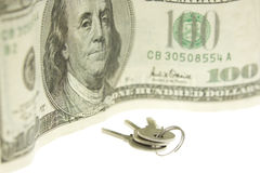 Keys and hundred dollars bill Royalty Free Stock Image