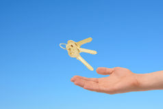 Keys In Hand Over Sky Background. Royalty Free Stock Photo