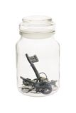 Keys inside glass jar Stock Photography