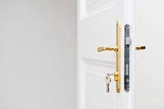 Keys in the keyhole with beautiful golden doorknob Royalty Free Stock Photo
