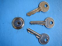Keys and a keyhole on a blue door Stock Image